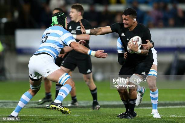 Vaea Fifita of New Zealand fends Matias Alemanno of Argentina during The Rugby Championship match between the New Zealand All Blacks and Argentina at...