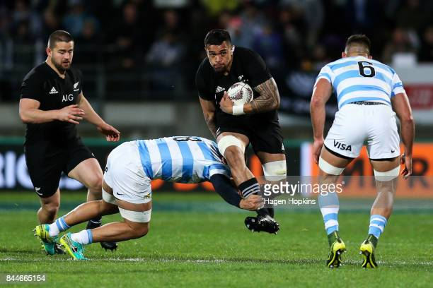 Vaea Fifita of New Zealand is tackled by Benjamin Macome of Argentina during The Rugby Championship match between the New Zealand All Blacks and...