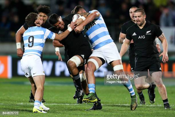 Vaea Fifita of New Zealand is tackled by Pablo Matera and Tomas Cubelli of Argentina during The Rugby Championship match between the New Zealand All...