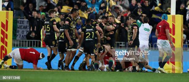 Vaea Fifita of the Hurricanes celebrates with team mates after scoring a late try during the match between the Hurricanes and the British Irish Lions...