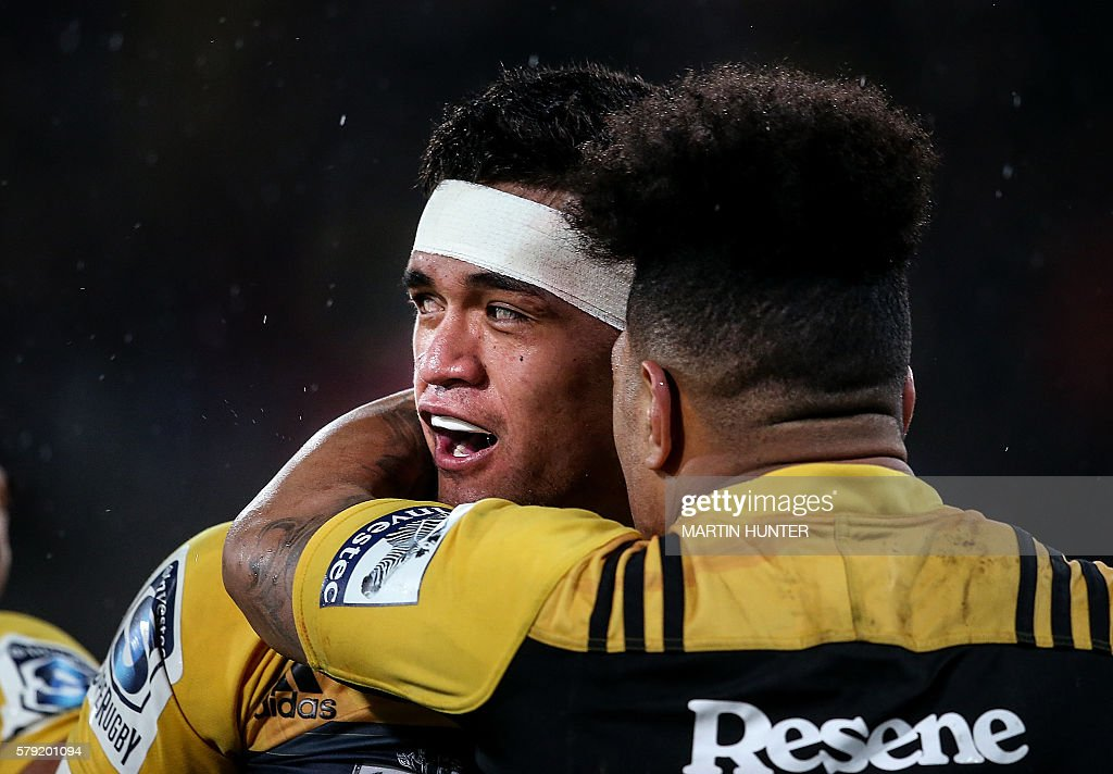 Vaea Fifita of the Hurricanes is congratulated by teammate Ardie Savea after scoring a try during the Super Rugby quarterfinal match between South...