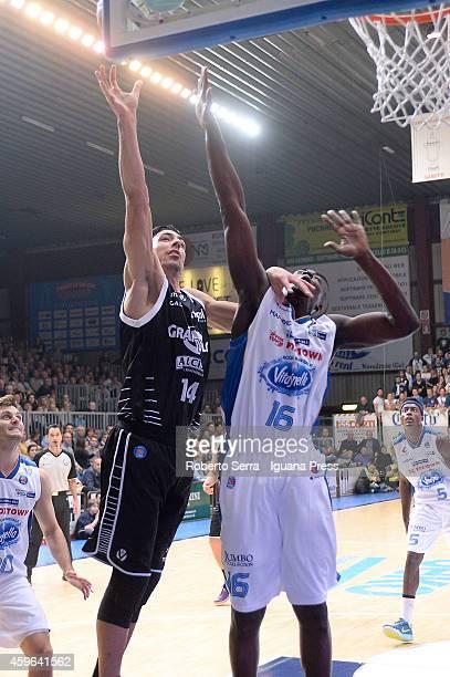 Vaòerio Mazzola of Granarolo competes with Cheikh Mbodj of Acqua Vitasnella looks over during the LegaBasket Serie A1 match between Acqua Vitasnella...