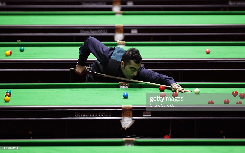 Vafaei Ayouri Hossein of Iran plays a shot against Chau Hon Man of Hong Kong during the Men's Snooker Round of 16 matches at Songdo Convensia during day seven of the 4th Asian Indoor & Martial Arts Games on July 5, 2013 in Incheon, South Korea.