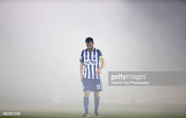 Vaggelis Nastos of Atromitos is seen as smoke from flares covers the pitch during the Superleague match between Atromitos FC and Olympiacos at...