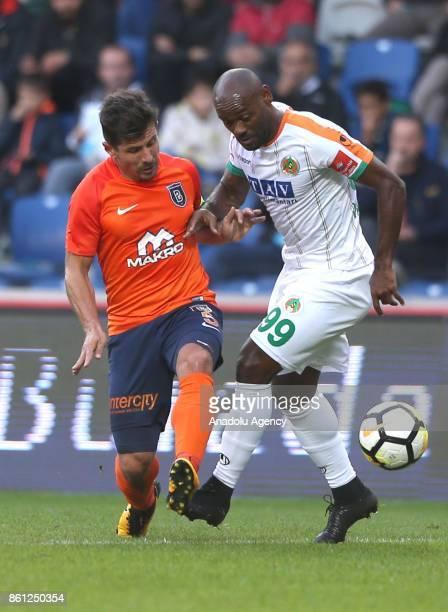 Vagner Love of Aytemiz Alanyaspor in action against Emre Belozoglu of Medipol Basaksehir during the Turkish Super Lig soccer match between Medipol...