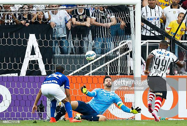 Vagner Love of Corinthians scores their first goal during the match between Corinthians and Cruzeiro for the Brazilian Series A 2015 at Arena...