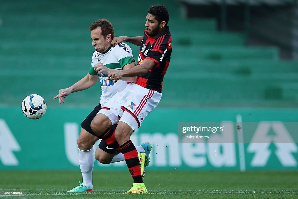 Vagner Love of Coritiba competes for the ball with Wallace of Flamengo during the match between Coritiba and Flamengo for the Brazilian Series A 2014 at Couto Pereira stadium on August 17, 2014 in Curitiba, Brazil.