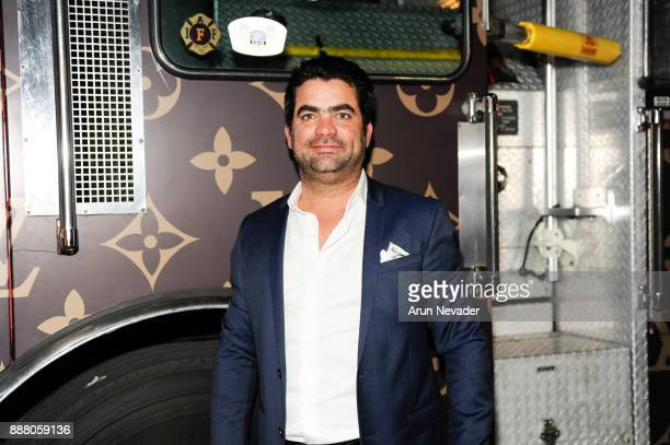 Vagu CEO Fernando Valero poses in front of the LitBasel vehicle during the cocktail reception at Vagu on December 7 2017 in Miami Florida