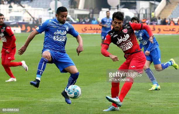 Vahid Amiri of Persepolis fights for ball against Omid Ebrahimi of Esteghlal during the derby football match between Esteghlal and Persepolis at the...