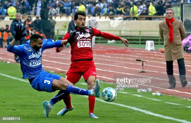 Vahid Amiri of Persepolis fights for ball against Robson Januario de Paula of Esteghlal during the derby football match between Esteghlal and...