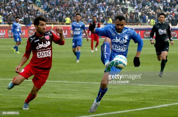Vahid Amiri of Persepolis fights for the ball against Robson of Esteghlal during the derby football match between Esteghlal and Persepolis at the...