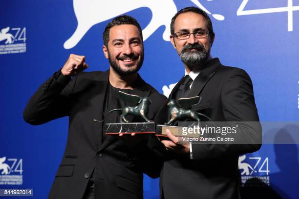 Vahid Jalilvand and Navid Mohammadzadeh pose with the Orizzonti Award for Best Director and Orizzonti Award for Best Actor for 'Bedoone Tarikh...