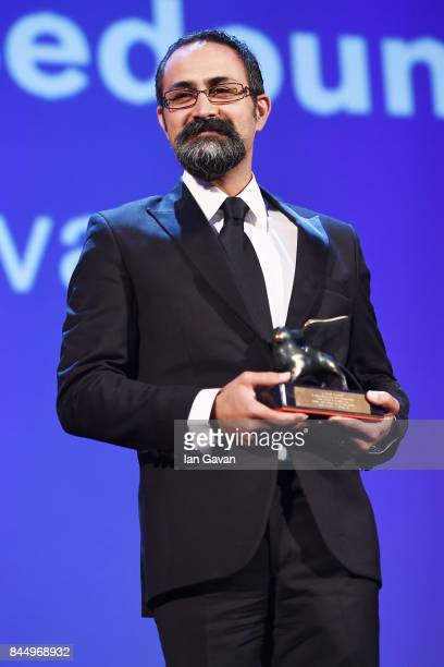 Vahid Jalilvand receives the Orizzonti Award for Best Director for Bedoone Tarikh Bedoone Emza during the Award Ceremony of the 74th Venice Film...