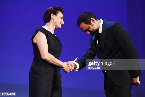 Vahid Jalilvand receives the Orizzonti Award for Best Director for Bedoone Tarikh Bedoone Emza from 'Orizzonti' jury Ami Canaan Mann during the Award...