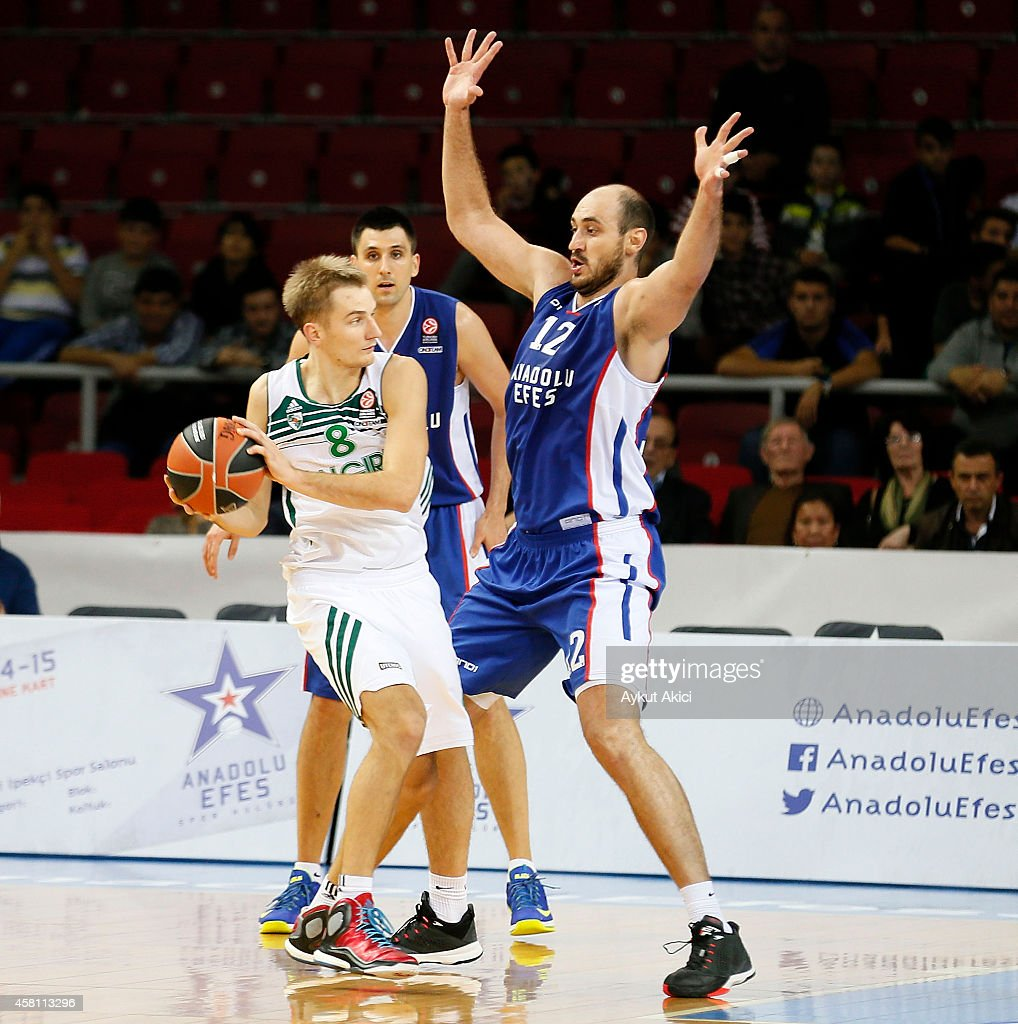 Vaidas Kariniauskas, #8 of Zalgiris Kaunas competes with <a gi-track='captionPersonalityLinkClicked' href=/galleries/search?phrase=Nenad+Krstic&family=editorial&specificpeople=202625 ng-click='$event.stopPropagation()'>Nenad Krstic</a>, #12 of Anadolu Efes Istanbul in action during the 2014-2015 Turkish Airlines Euroleague Basketball Regular Season Date 3 game between Anadolu Efes Istanbul v Zalgiris Kaunas at Abdi Ipekci Arena on October 30, 2014 in Istanbul, Turkey.