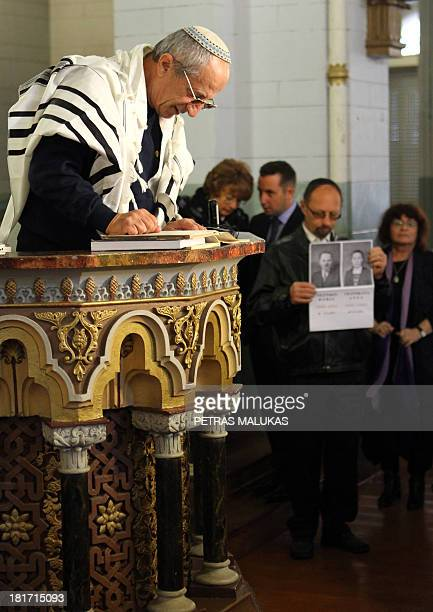 Vaidotas Beniusis A rabbi reads names of Holocaust victims during a memorial service on September 23 2013 in Vilnius 'synagogue On Monday members of...