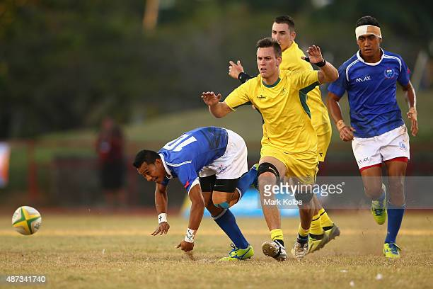 Vaifogaloa Asafo of Samoa kicks ahead during the boys match between Australia and Samoa in the rugby sevens competition at the Apia Park Sports...