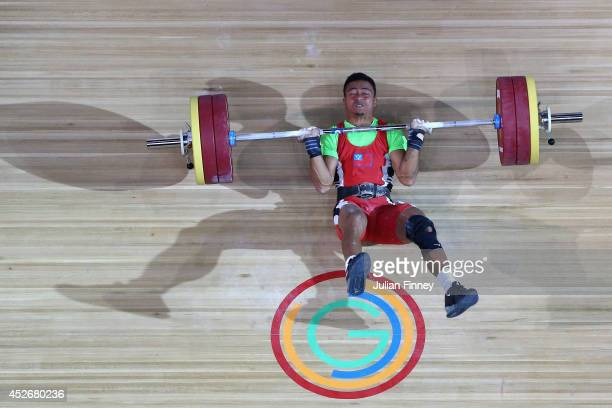 Vaipava Ioane of Samoa falls backwards after a failed lift in the Men's 62kg Weightlifting at Scottish Exhibition And Conference Centre during day...