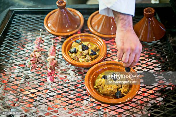 Tagine dishes being prepared on the charcoal grill at Mazagan Moroccan restaurant in Arlington VA