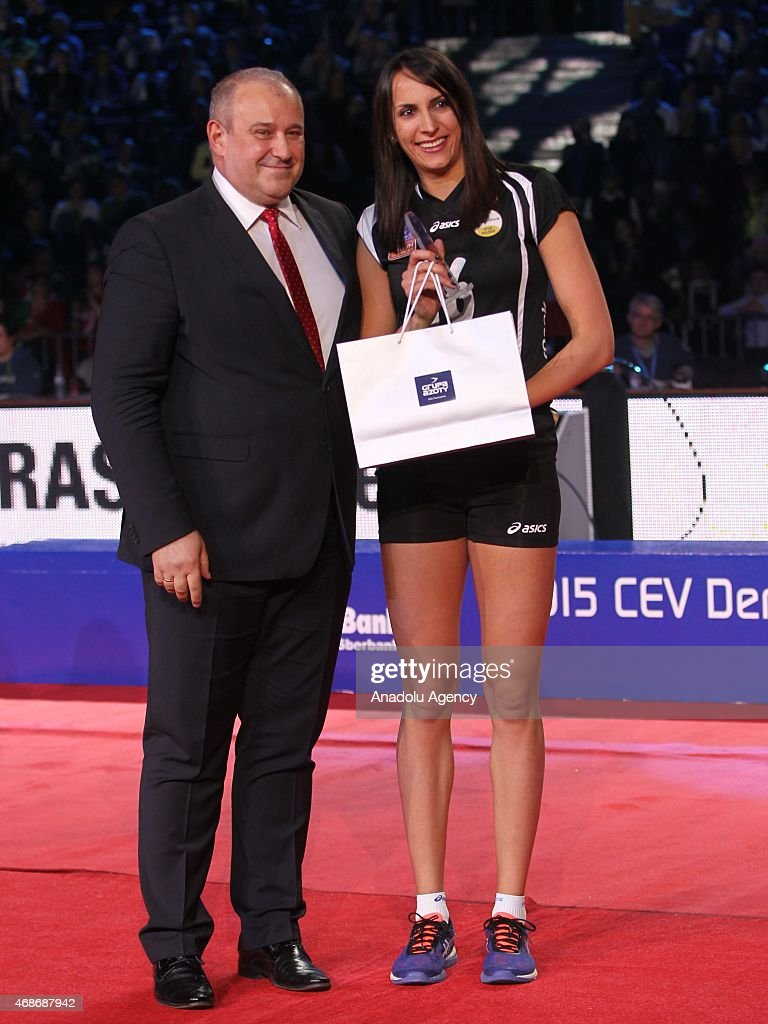 Vakifbank's volleyball player Milena Rasic (R) is awarded as she gets in Dream Team within the CEV DenizBank Women Volleyball Champions League at Azoty Arena, Szczecin, Poland on March 05, 2015.