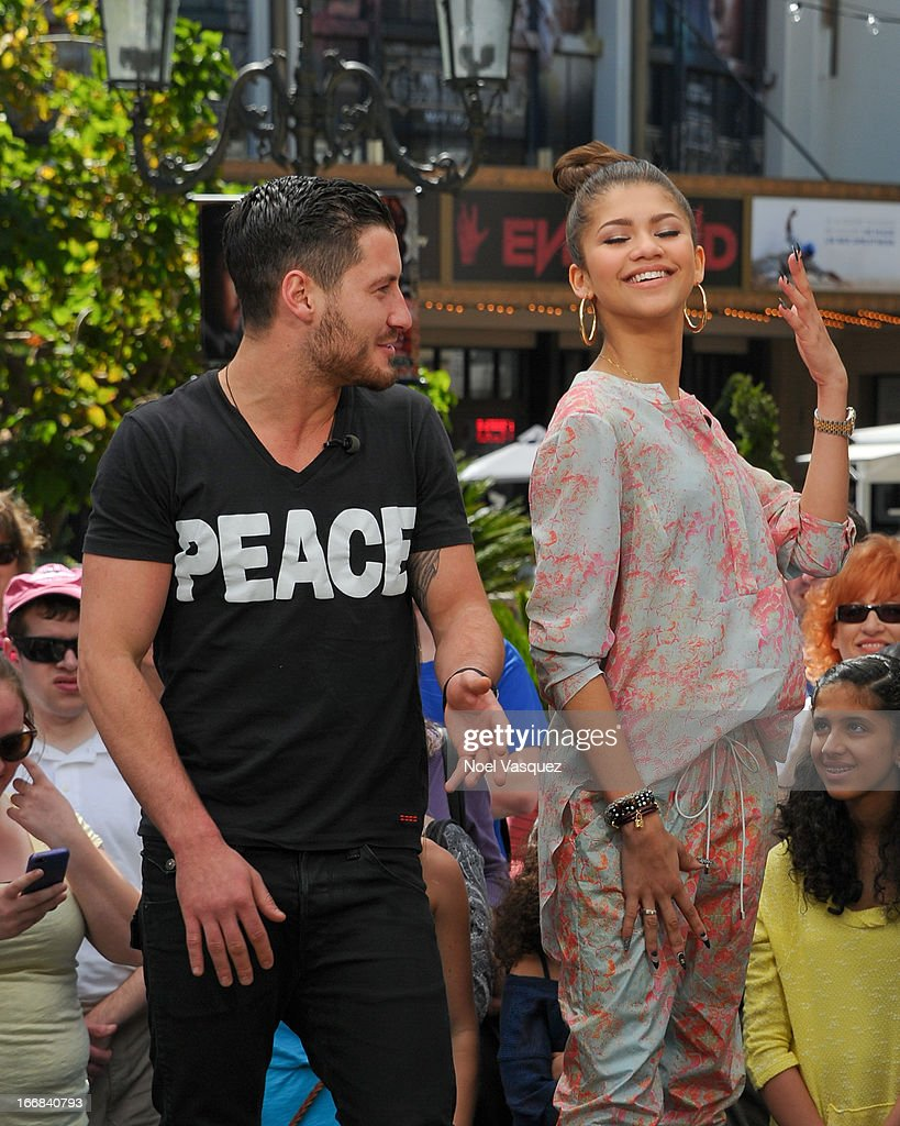 Val Chmerkovskiy (L) and Zendaya Coleman visit 'Extra' at The Grove on April 17, 2013 in Los Angeles, California.