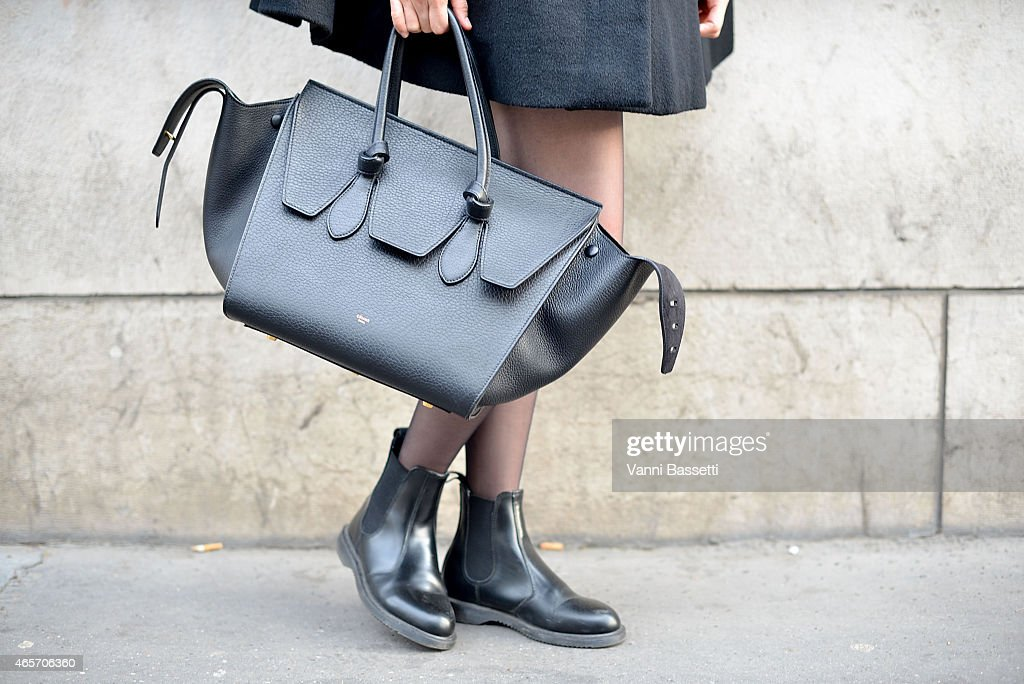 Val Tseng poses wearing Dr Martens shoes and Celine bag on Day 7 of Paris Fashion Week Womenswear FW15 on March 9 2015 in Paris France