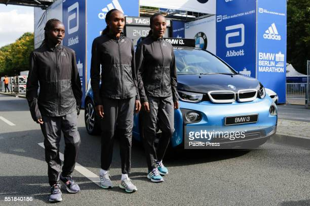 Valary Aiyabei from Kenya Gladys Cherono from Kenya and Amane Beriso from Ethiopia pose for the cameras at the starting line The leading male and...