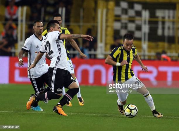 Valbuena of Fenerbahce in action against Medel of Besiktas during the Turkish Super Lig week 6 soccer match between Fenerbahce and Besiktas at Ulker...