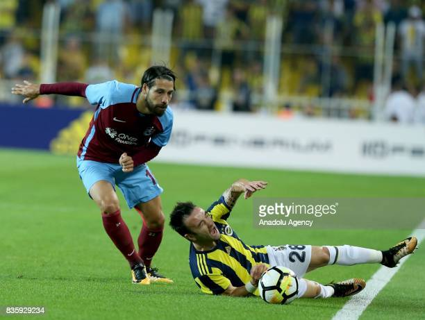 Valbuena of Fenerbahce vies with Olcay Sahan of Trabzonspor during Turkish Super Lig soccer match between Fenerbahce and Trabzonspor at the Ulker...