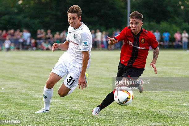 Valdemar Anton of Hannover challenges Brandon of Mallorca during the preseason friendly match between Hannover 96 and RCD Mallorca at WahrenDorff...