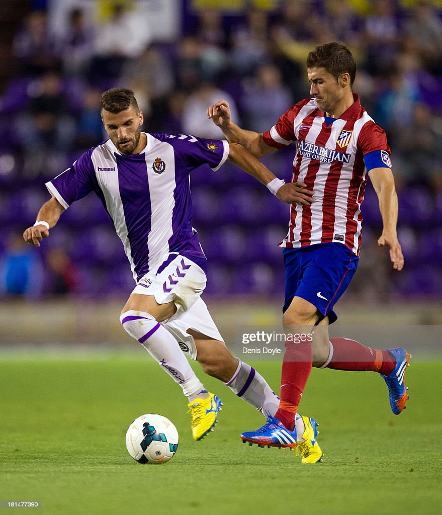 Valdet Rama (L) of Real Valladolid CF battles for the ball with Gabi of Club Atletico de Madrid during the La Liga match between Real Valladolid CF and Club Atletico de Madrid at Estadio Jose Zorilla on September 21, 2013 in Valladolid, Spain.