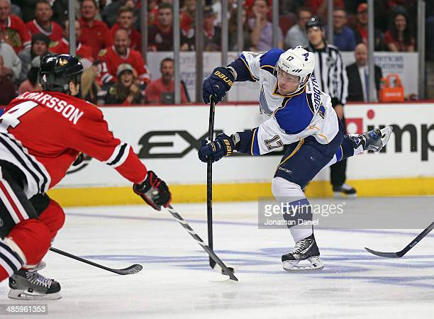 Valdimir Sobotka of the St Louis Blues shoots against Niklas Hjalmarsson of the Chicago Blackhawks in Game Three of the First Round of the 2014 NHL...
