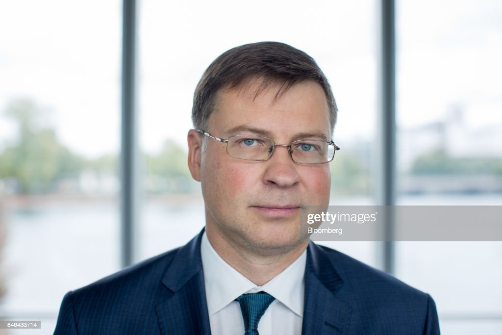 Valdis Dombrovskis, vice president of the European Commission, poses for a photograph following the State of the Union speech at the European Parliament in Strasbourg, France, on Wednesday, Sept. 13, 2017. In a sign of the EUs renewed confidence, European Commission President Jean-Claude Juncker will push for free-trade pacts withAustralia and New Zealandat a time when the U.S. is turning inward, along with a bloc-wide system for screening foreign takeovers and deeper euro-area banking integration. Photographer: Jasper Juinen/Bloomberg via Getty Images