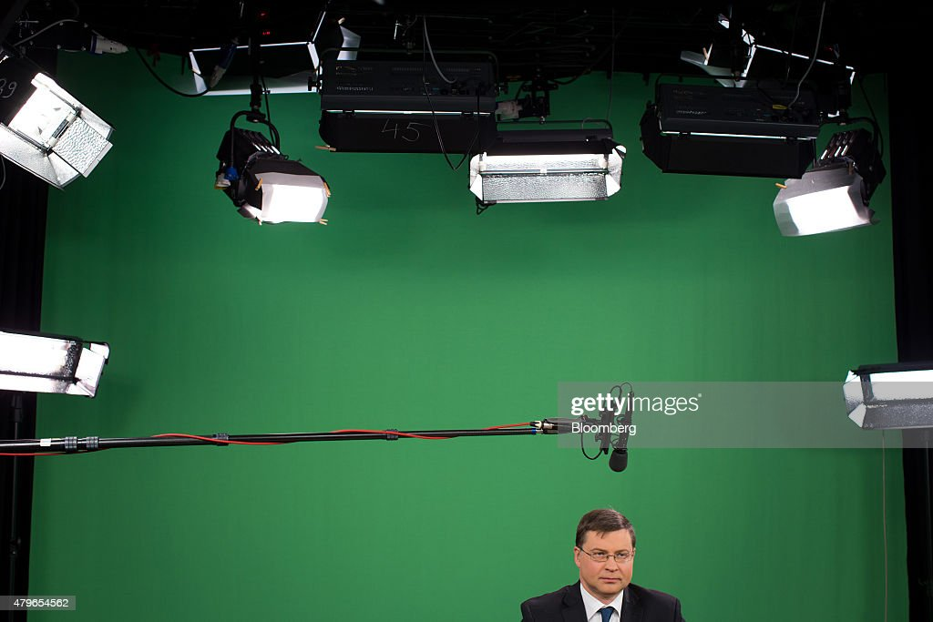 <a gi-track='captionPersonalityLinkClicked' href=/galleries/search?phrase=Valdis+Dombrovskis&family=editorial&specificpeople=5732119 ng-click='$event.stopPropagation()'>Valdis Dombrovskis</a>, vice president of the European Commission, sits under studio lights and a boom microphone ahead of a Bloomberg Television interview in Brussels, Belgium, on Monday, July 6, 2015. Greece forfeited a November 2012 offer of debt relief by letting its bailout expire and is starting from a blank slate in seeking easier repayment terms, Dombrovskis said. Photographer: Jasper Juinen/Bloomberg via Getty Images