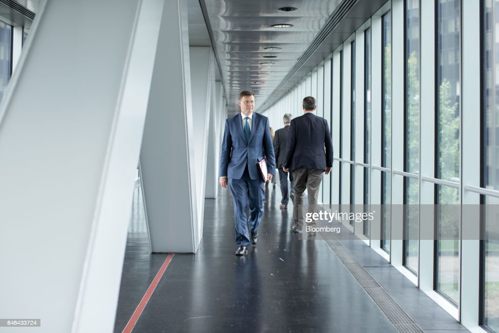 Valdis Dombrovskis, vice president of the European Commission, walks through the corridors of the European Parliament following the State of the Union speech in Strasbourg, France, on Wednesday, Sept. 13, 2017. In a sign of the EUs renewed confidence, European Commission President Jean-Claude Juncker will push for free-trade pacts withAustralia and New Zealandat a time when the U.S. is turning inward, along with a bloc-wide system for screening foreign takeovers and deeper euro-area banking integration. Photographer: Jasper Juinen/Bloomberg via Getty Images