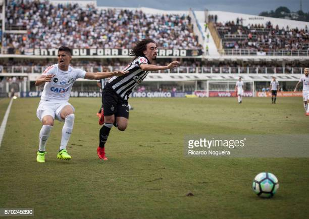 Valdivia of Atletico Mineiro battles for the ball with Daniel Guedes of Santos during the match between Santos and Atletico Mineiro as a part of...