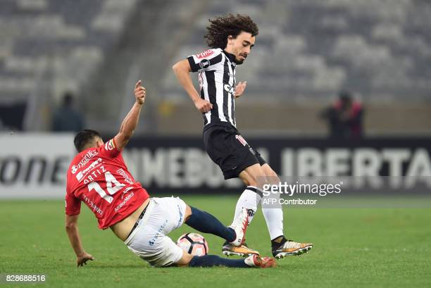 Valdivia of Brazil's Atletico Mineiro vies for the ball with Jorge Antonio Ortiz of Bolivia's Jorge Wilstermann during their 2017 Copa Libertadores...