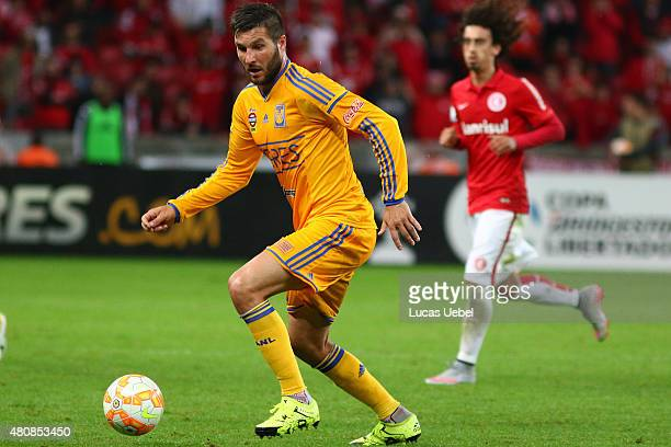 Valdivia of Internacional battles for the ball against Andre Pierre Gignac of Tigres during the match between Internacional v Tigres as part of Copa...