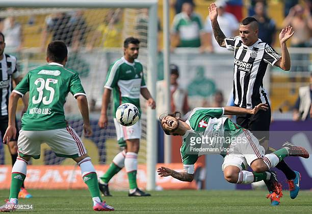 Valdivia of Palmeiras fights for the ball with Alison of Santos during the match between Palmeiras and Santos for the Brazilian Series A 2014 at...