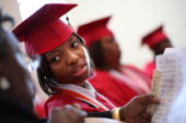 Valedictorian Lawyna Taylor and other students of the first and last graduating class of Livingston High School prepare for their commencement June 3...