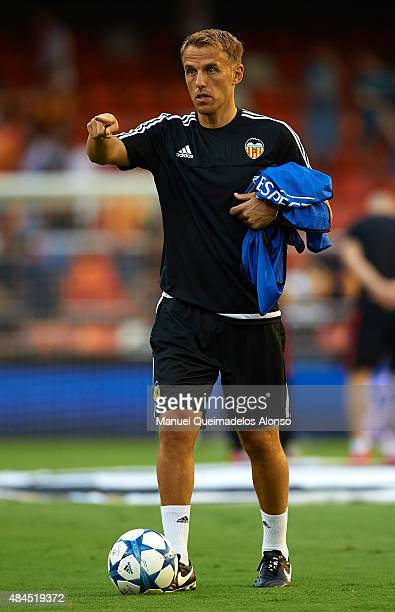 Valencia CF assistant coach Phil Neville gestures prior to the UEFA Champions League Qualifying Round Play Off First Leg match between Valencia CF...