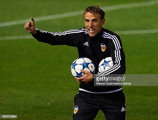 Valencia CF assistant coach Phil Neville gives instructions during a training session ahead of Wednesday's UEFA Champions League Group H match...