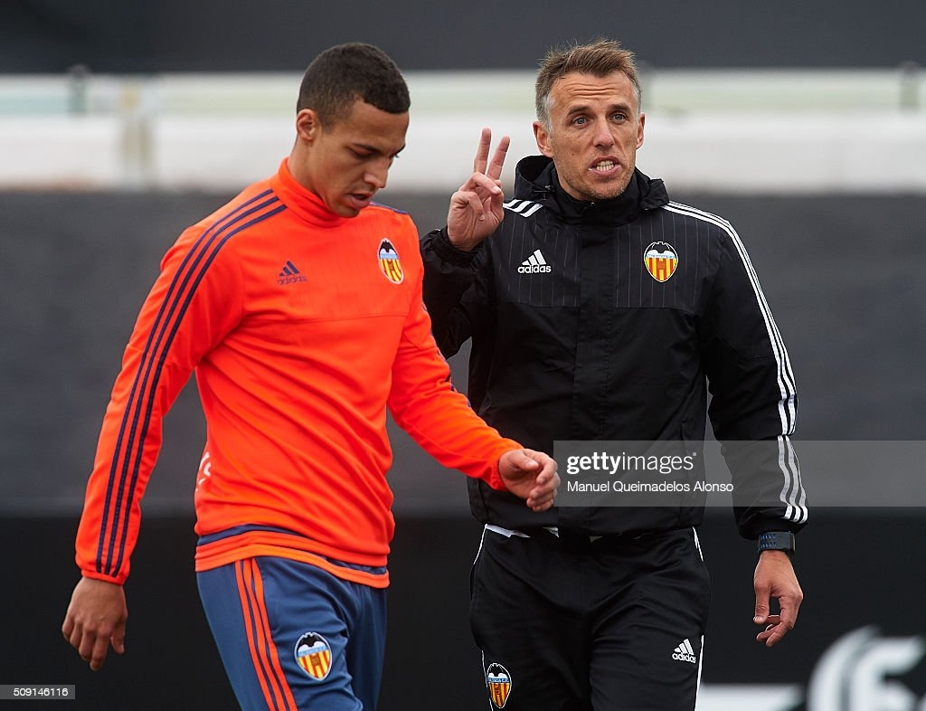 Valencia CF assistant coach <a gi-track='captionPersonalityLinkClicked' href=/galleries/search?phrase=Phil+Neville&family=editorial&specificpeople=201898 ng-click='$event.stopPropagation()'>Phil Neville</a> gives instructions during a training session ahead of Wednesday's Copa del Rey Semi Final, second leg match between Valencia CF and FC Barcelona at Paterna Training Centre on February 9, 2016 in Valencia, Spain.