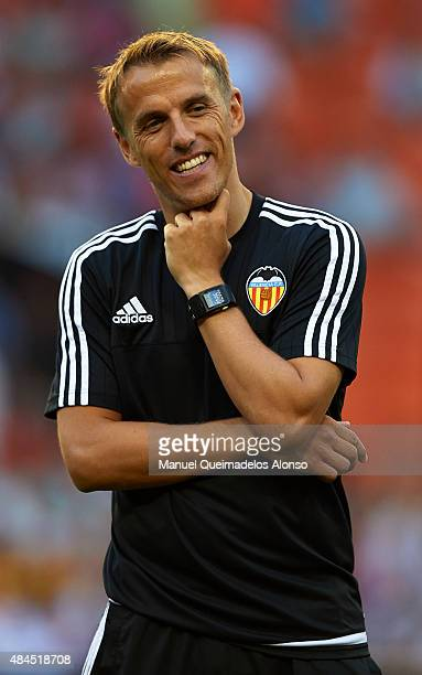 Valencia CF assistant coach Phil Neville smiles prior to the UEFA Champions League Qualifying Round Play Off First Leg match between Valencia CF and...