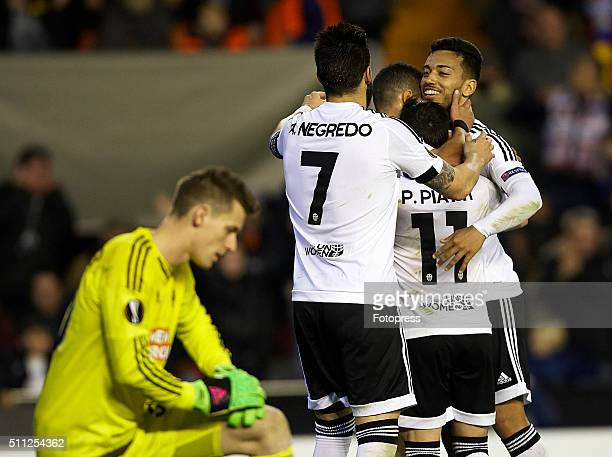 Valencia CF players celebrate during the UEFA Europa League round of 32 first leg match between Valencia CF and Rapid Vienna at Estadi de Mestalla on...