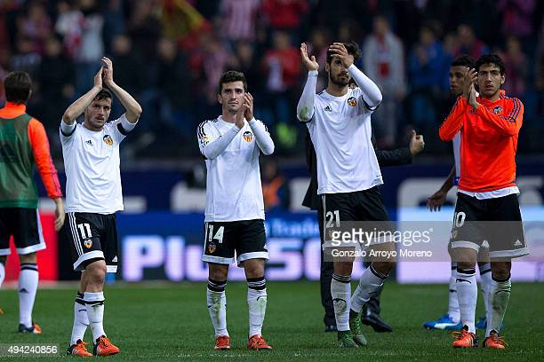Valencia CF players Pablo Piatti Jose Gaya Andre Gomes and Dani Parejo greet their fan after loosing during the La Liga amtch between Club Atletico...