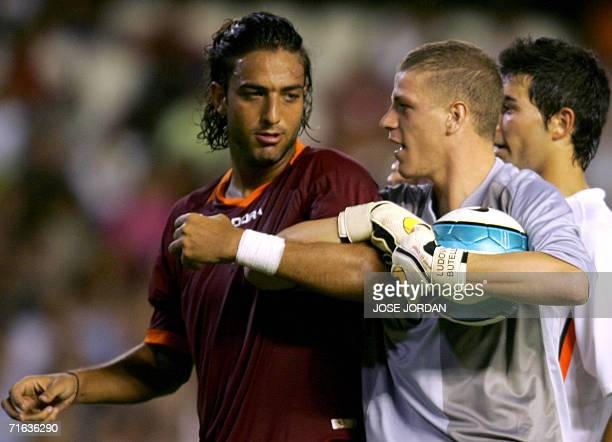 Valencia goalkeeper French Ludovic Butelle vies with Roma Egyptian Hussein Mido during the Orange Trophy match against Valencia at Mestalla Stadium...
