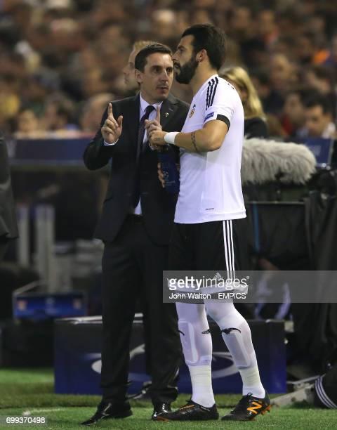 Valencia manager Gary Neville with Alvaro Negredo on the touchline