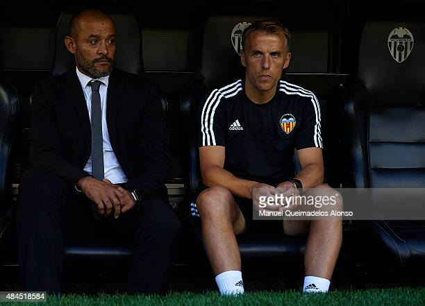 Valencia manager Nuno Espirito Santo and his assistant coach Phil Neville prior to the UEFA Champions League Qualifying Round Play Off First Leg...