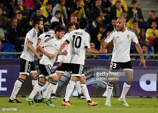 Valencia players celebrate after scoring during the Spanish Copa del Rey football match UD Las Palmas vs Valencia CF at the Estadio de Gran Canaria...
